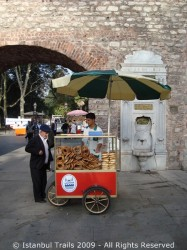Street vendor selling simit and açma.
